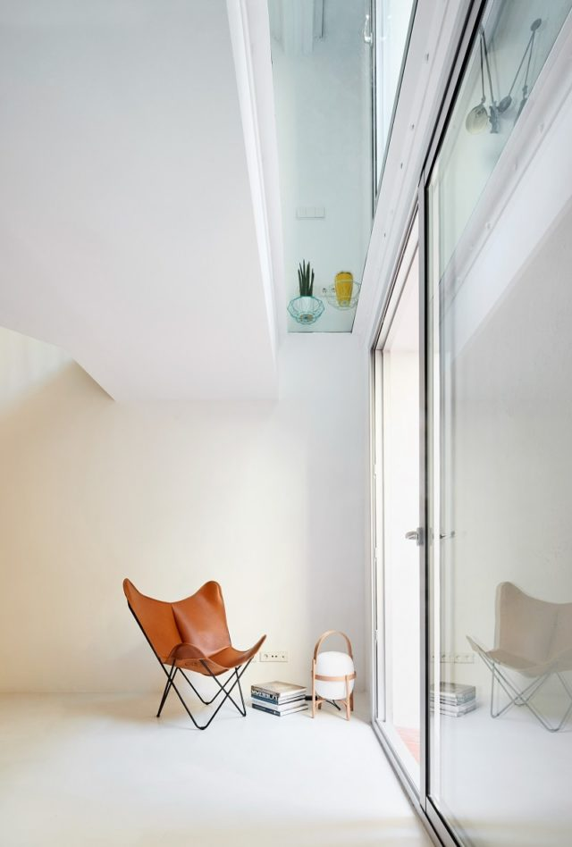 Brown Leather Chair Duplex Apartment by Raul Sanchez Architects, Barcelona, Spain
