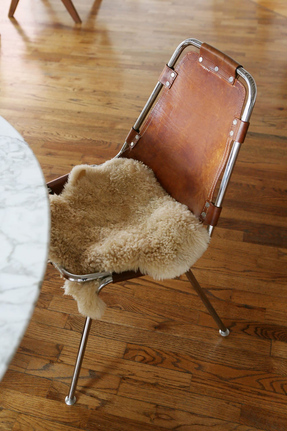 Charlotte Perriand Dining Chairs - Leather sling with swatches of fur